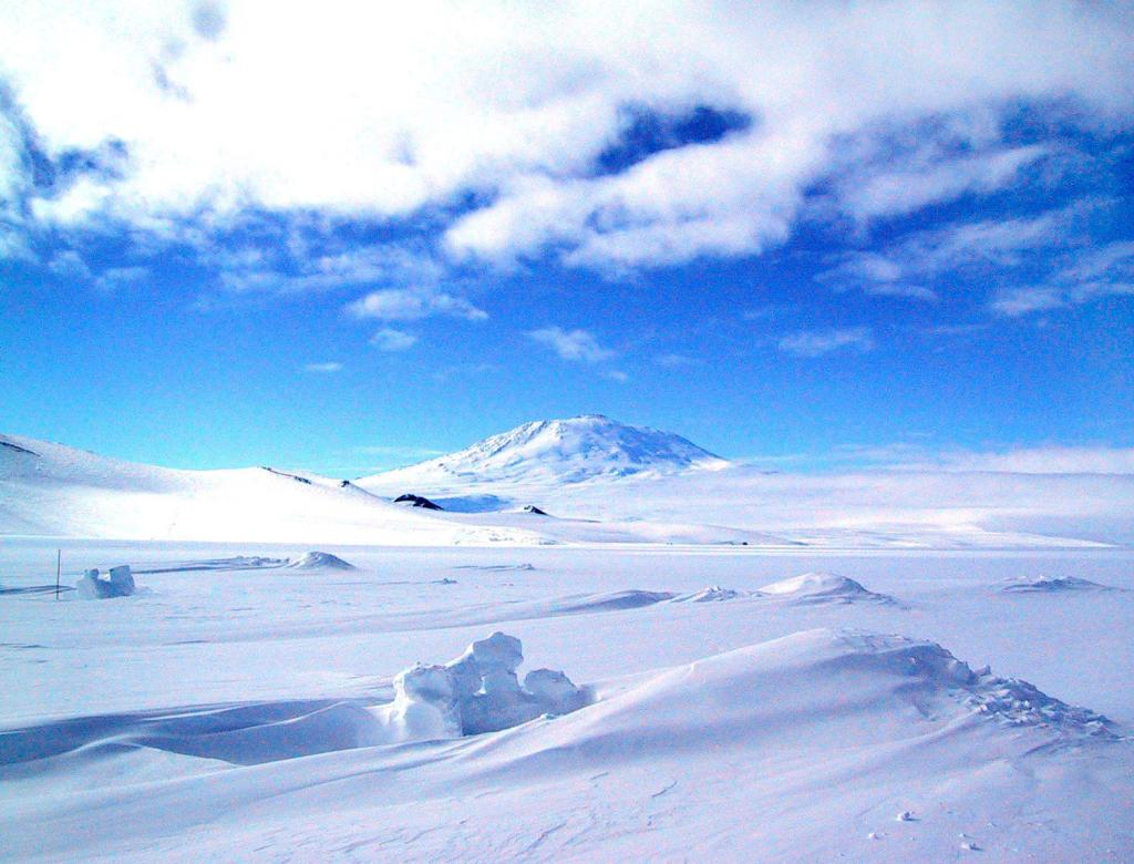 "Mt. Erebus looms over McMurdo Station in Antarctica. Image Credit:  Courtesy Ted Scambos and Rob Bauer, NSIDC  <a href=""http://nsidc.org/antarctica/megadunes/"">Megadunes Web site</a> (<a href=""/cryosphere/gallery/photo/33024"">View photo detail.</a>) <br>"