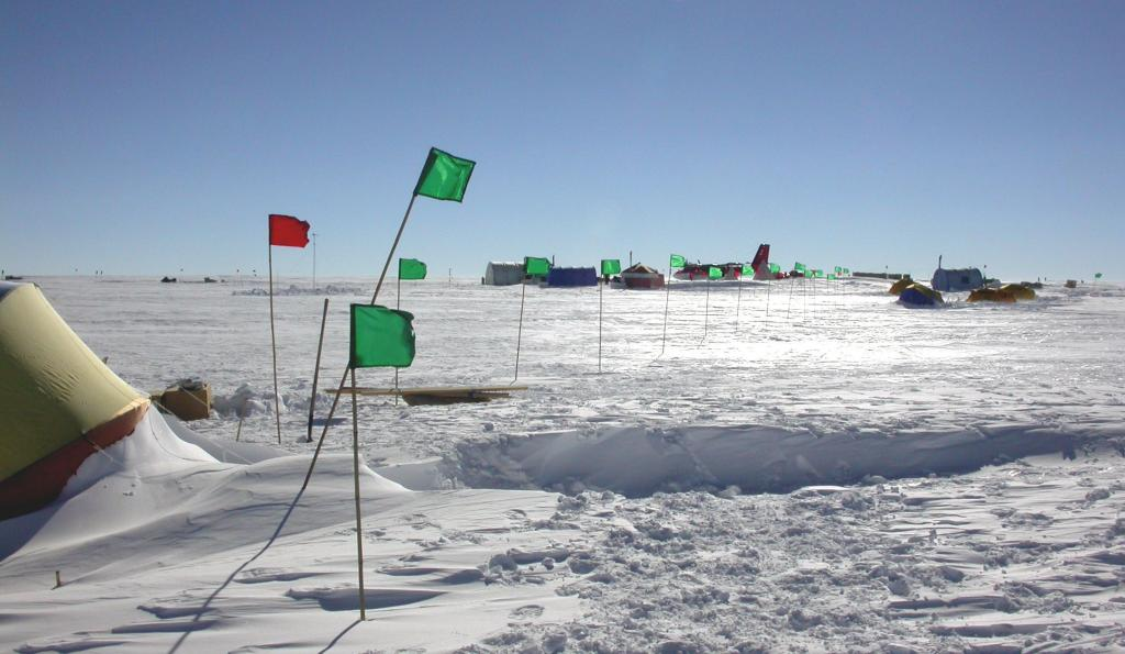 "Flags led to the Endurance tent from the main camp of the Antarctic Megadunes expedition, to help researchers find their way around in low visibility conditions. Image Credit:  Courtesy Ted Scambos and Rob Bauer, NSIDC  <a href=""http://nsidc.org/antarctica/megadunes/"">Megadunes Web site</a> (<a href=""/cryosphere/gallery/photo/33028"">View photo detail.</a>) <br>"