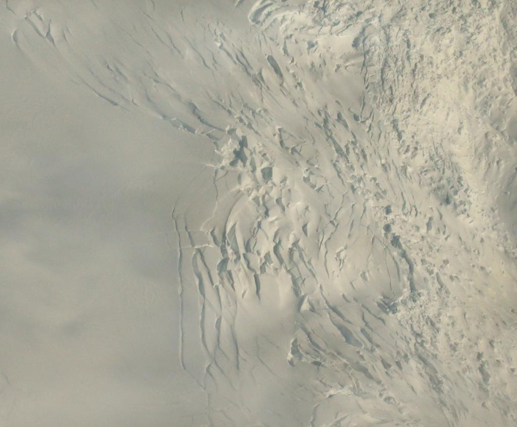 "This aerial image of an icefall shows a cliff of ice, formed by a region of rapidly flowing ice. Image Credit:  Courtesy Ted Scambos and Rob Bauer, NSIDC  <a href=""http://nsidc.org/antarctica/megadunes/"">Megadunes Web site</a> (<a href=""/cryosphere/gallery/photo/33038"">View photo detail.</a>) <br>"