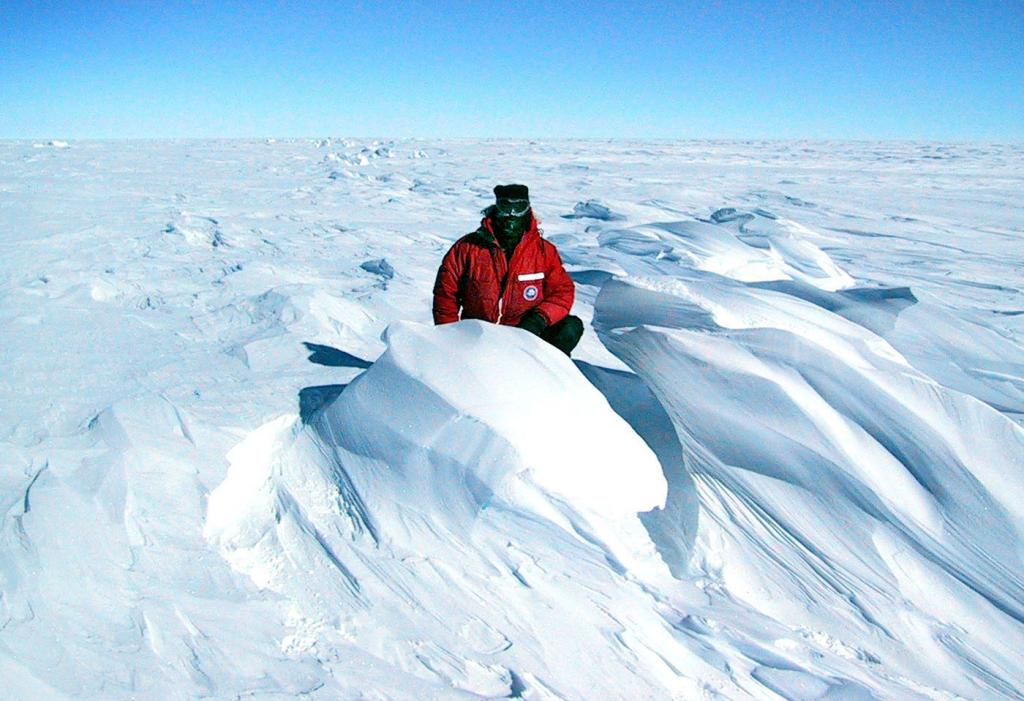 "Rob Bauer stands next to a sastrugi in the Megadunes area. Image Credit:  Courtesy Ted Scambos and Rob Bauer, NSIDC  <a href=""http://nsidc.org/antarctica/megadunes/"">Megadunes Web site</a> (<a href=""/cryosphere/gallery/photo/33034"">View photo detail.</a>) <br>"