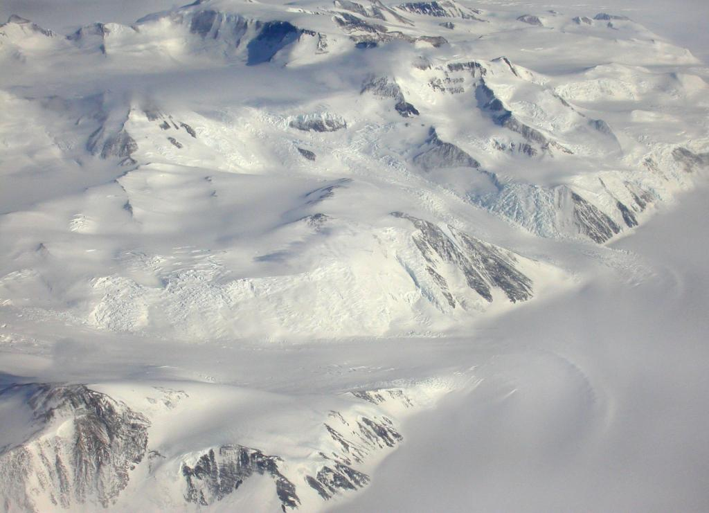 "The Royal Society Range in Antarctica rises to 4000 meters (13,000 feet) at its highest point.  Image Credit:  Courtesy Ted Scambos and Rob Bauer, NSIDC  <a href=""http://nsidc.org/antarctica/megadunes/"">Megadunes Web site</a> (<a href=""/cryosphere/gallery/photo/33041"">View photo detail.</a>) <br>"
