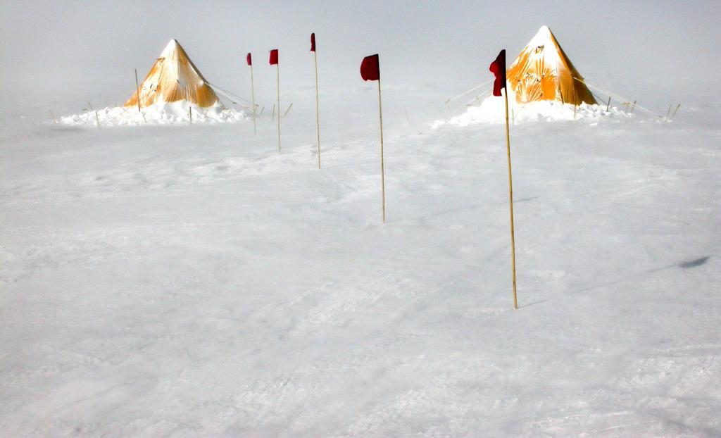 "Snow builds up heavily on one side of the Scott tents at the Megadunes camp. Image Credit:  Courtesy Ted Scambos and Rob Bauer, NSIDC  <a href=""http://nsidc.org/antarctica/megadunes/"">Megadunes Web site</a> (<a href=""/cryosphere/gallery/photo/32973"">View photo detail.</a>) <br>"