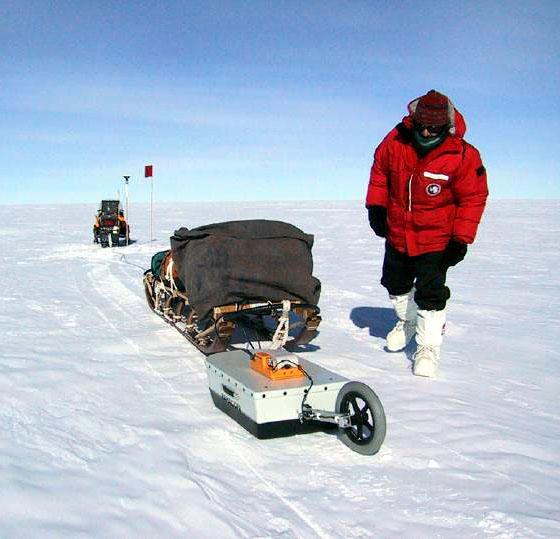"Ted Scambos checks on the GPR/GPS system. Image Credit: Courtesy Ted Scambos and Rob Bauer, NSIDC  <a href=""http://nsidc.org/antarctica/megadunes/"">Megadunes Web site</a> (<a href=""/cryosphere/gallery/photo/33052"">View photo detail.</a>) <br>"