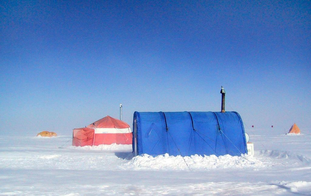 "The Megadunes expedition camp tents included the Arctic Chief (red) and the PolarHaven (blue). Image Credit:  Courtesy Ted Scambos and Rob Bauer, NSIDC  <a href=""http://nsidc.org/antarctica/megadunes/"">Megadunes Web site</a> (<a href=""/cryosphere/gallery/photo/33057"">View photo detail.</a>) <br>"