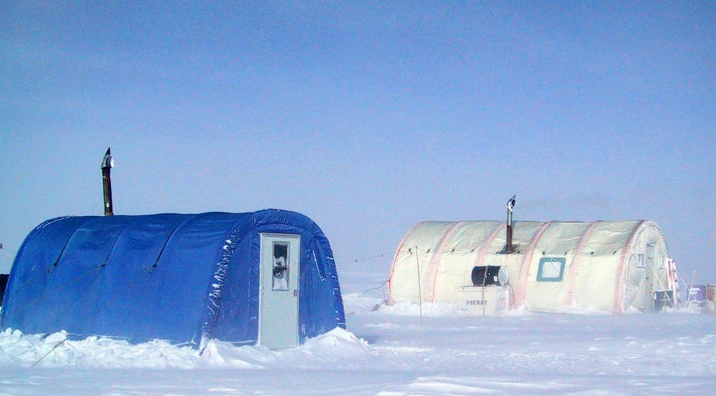"The Megadunes expedition camp tents included the PolarHaven (blue) and the WeatherHaven (white). Image Credit:  Courtesy Ted Scambos and Rob Bauer, NSIDC  <a href=""http://nsidc.org/antarctica/megadunes/"">Megadunes Web site</a> (<a href=""/cryosphere/gallery/photo/32972"">View photo detail.</a>) <br>"