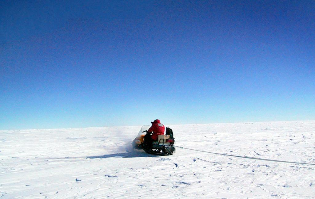 "Ted Scambos and Rob Bauer tow the GPS/GPR system to survey the Megadunes area. Image Credit:  Courtesy Ted Scambos and Rob Bauer, NSIDC  <a href=""http://nsidc.org/antarctica/megadunes/"">Megadunes Web site</a> (<a href=""/cryosphere/gallery/photo/33058"">View photo detail.</a>) <br>"