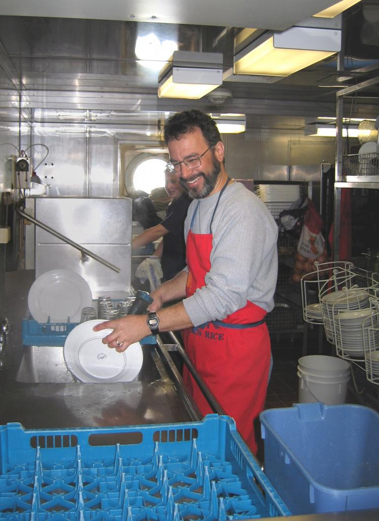 "Ted Scambos, helping out by cleaning and drying off dishes, down in the galley. Photo Credit: Courtesy Ted Scambos, NSIDC (<a href=""/cryosphere/gallery/photo/33200"">View photo detail.</a>) <br>"