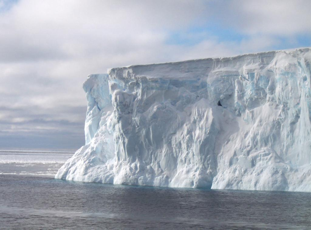 "The iceberg seen on the ARISE Cruise, surrounded by cake ice in the background. Photo Credit: Courtesy Paul Endersby (<a href=""/cryosphere/gallery/photo/33202"">View photo detail.</a>) <br>"