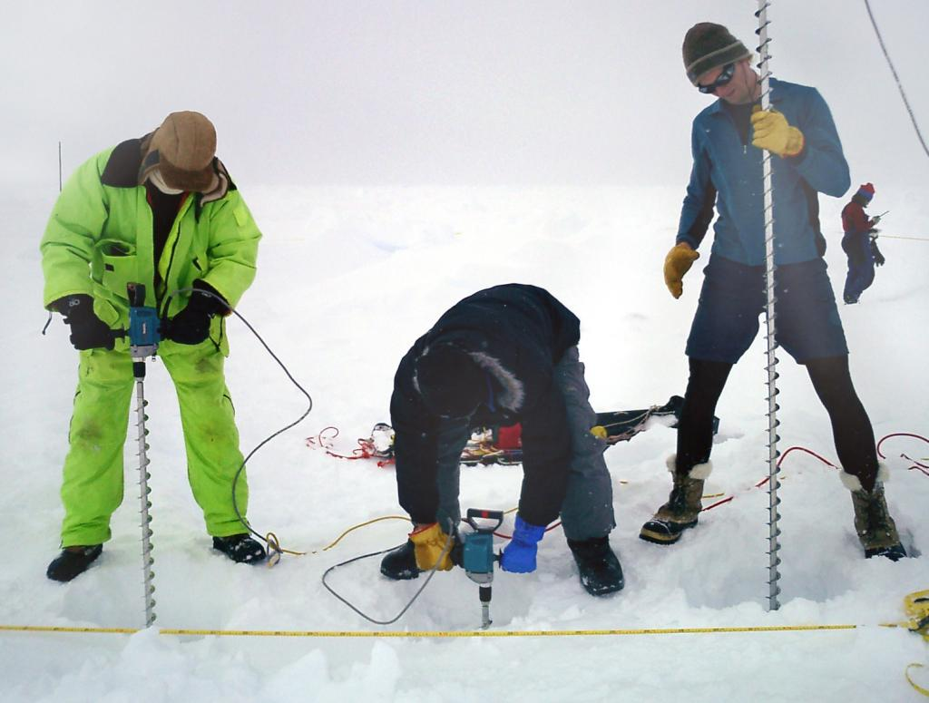 "The ""chain gang"" hard at work, drilling into the sea ice and taking samples for their research. Photo Credit: NSIDC Courtesy Anthony Petty (<a href=""/cryosphere/gallery/photo/33210"">View photo detail.</a>) <br>"