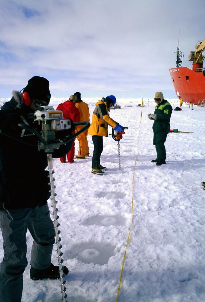 "Terry Haran (center, middleground) drilling core samples with the team. Photo Credit: Courtesy Ted Scambos, NSIDC (<a href=""/cryosphere/gallery/photo/33218"">View photo detail.</a>) <br>"