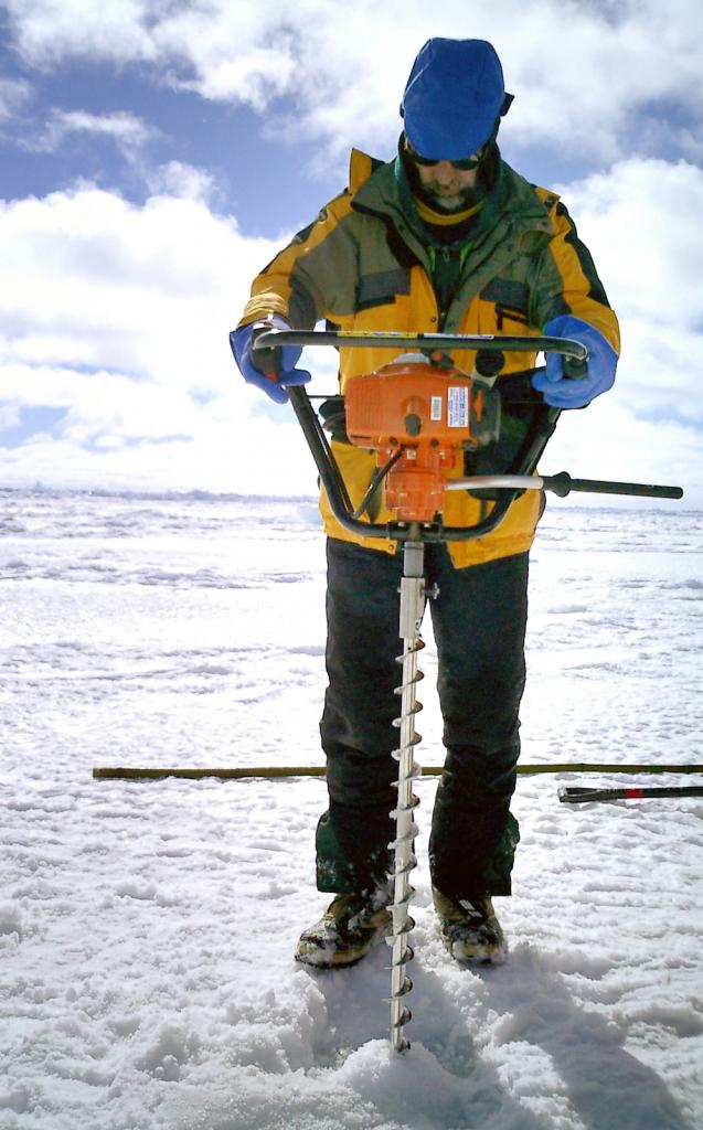 "Terry Haran drilling core samples with the team. Photo Credit: Courtesy Ted Scambos, NSIDC (<a href=""/cryosphere/gallery/photo/33220"">View photo detail.</a>) <br>"