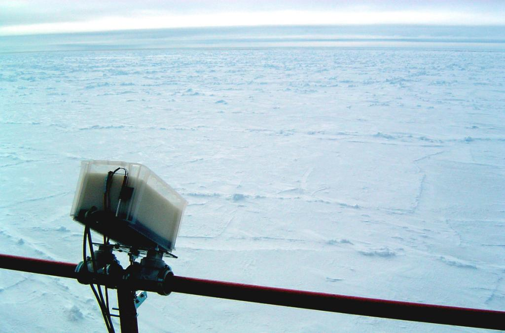 "The Heitronics KT-19.82 thermal radiometer, mounted to the port side rail of the Aurora Australis, to measure the skin temperature of the sea ice. Photo Credit: Courtesy Ted Scambos, NSIDC (<a href=""/cryosphere/gallery/photo/33230"">View photo detail.</a>) <br>"