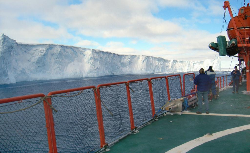 "As the Aurora Australis passes by an iceberg, the crew aboard take video footage and photographs to remember this particular momentPhoto Credit: NSIDC Courtesy Andi Pfaffling (<a href=""/cryosphere/gallery/photo/33246"">View photo detail.</a>) <br>"