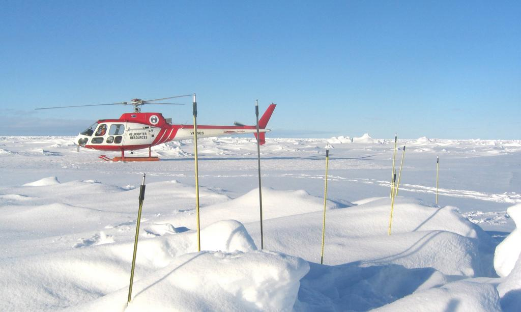 "The AS350 Squirrel (VH-SES) helicopter awaiting its return to the Aurora Australis. Photo Credit: NSIDC Courtesy Alice O'Connor (<a href=""/cryosphere/gallery/photo/33257"">View photo detail.</a>) <br>"