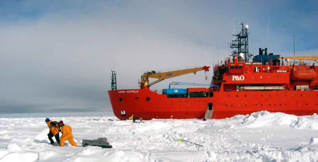 "Ted Scambos and Terry Haran hauling their equipment to the ice site, after having transported it off the icebreaker. Photo Credit: NSIDC Courtesy Robert Massom (<a href=""/cryosphere/gallery/photo/33258"">View photo detail.</a>) <br>"
