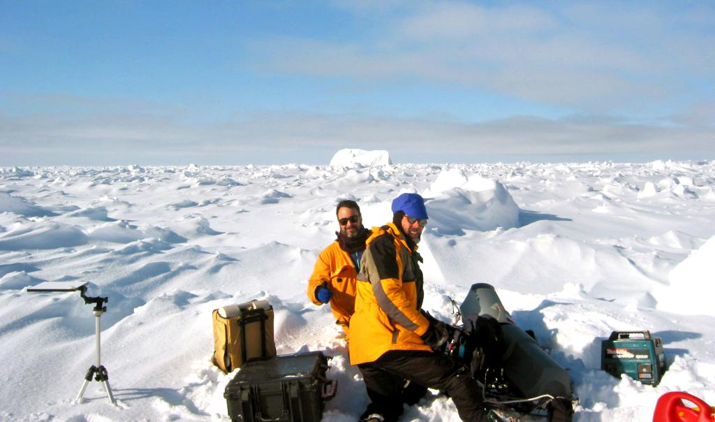 "Terry Haran (front) and Ted Scambos (back), hard at work on one of their ice sites. Photo Credit: NSIDC Courtesy Robert Massom (<a href=""/cryosphere/gallery/photo/33260"">View photo detail.</a>) <br>"