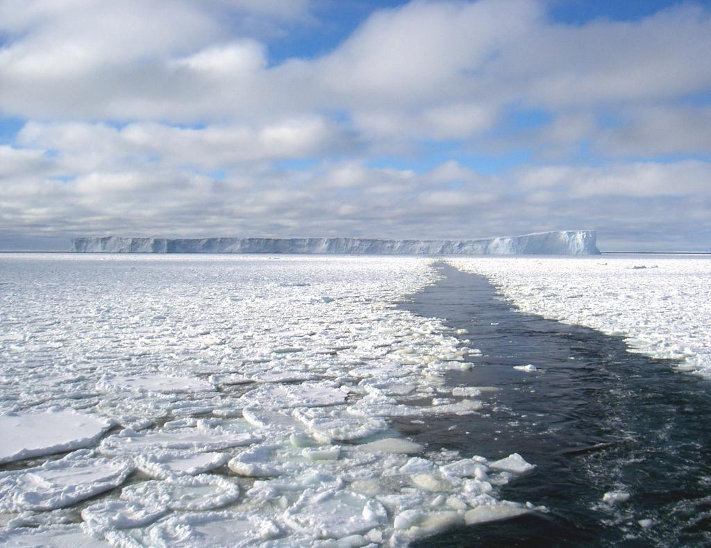 "The trail left behind by the Aurora Australis after navigating past the iceberg in the background. Photo Credit: NSIDC Courtesy Andi Pfaffling (<a href=""/cryosphere/gallery/photo/33266"">View photo detail.</a>) <br>"