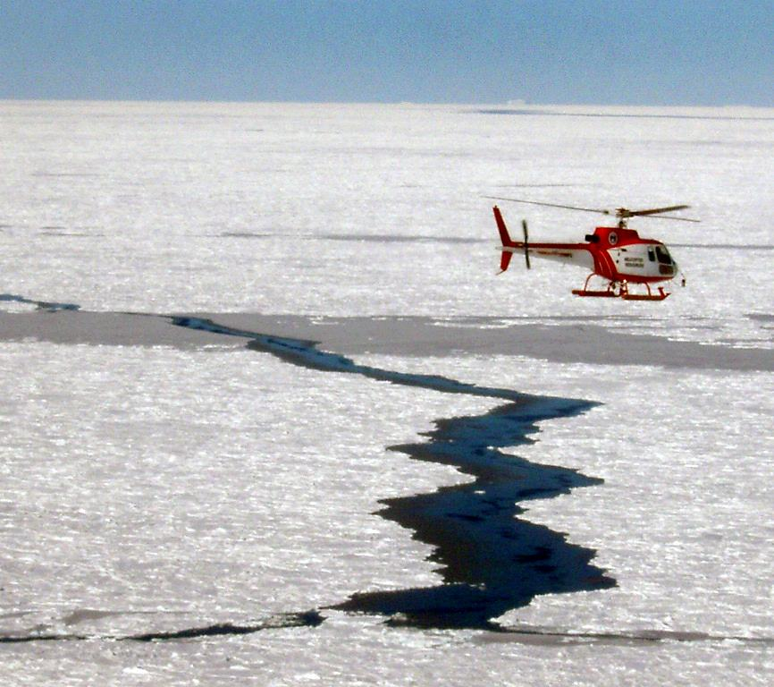 "An aerial view of the helicopter taking data of the sea ice below. Photo Credit: Courtesy Ted Scambos, NSIDC (<a href=""/cryosphere/gallery/photo/33289"">View photo detail.</a>) <br>"