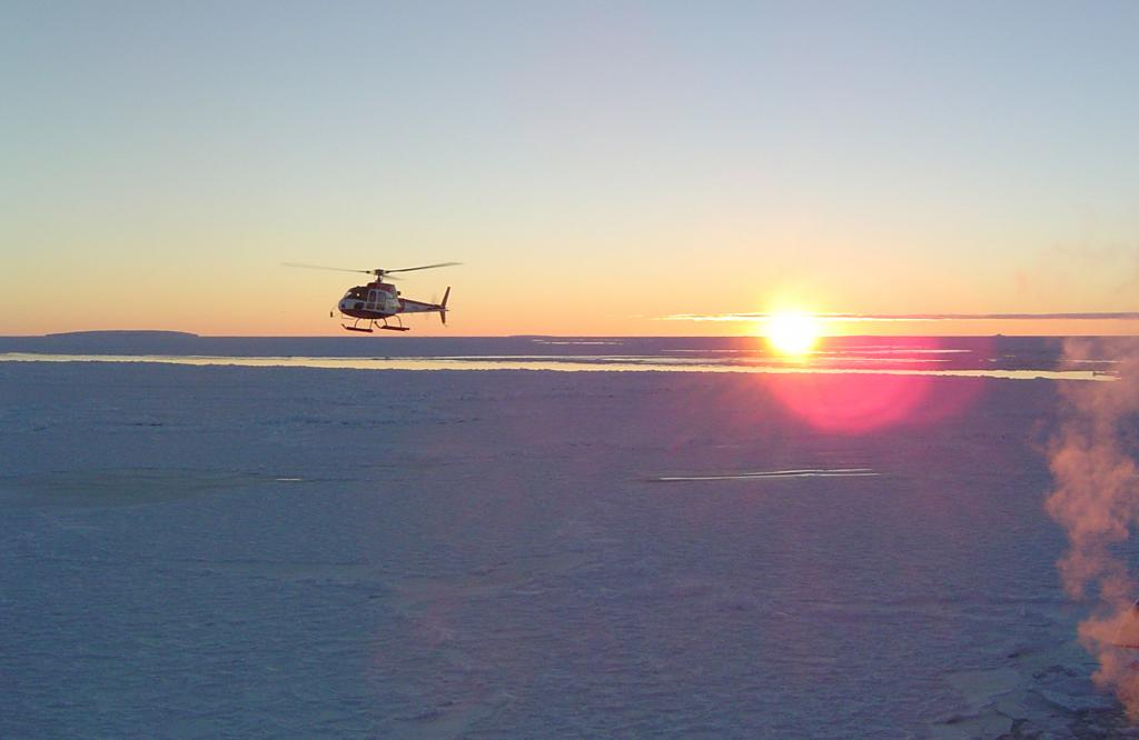 "The team returning from an aerial photo flight. Photo Credit: Courtesy Ted Scambos, NSIDC (<a href=""/cryosphere/gallery/photo/33292"">View photo detail.</a>) <br>"