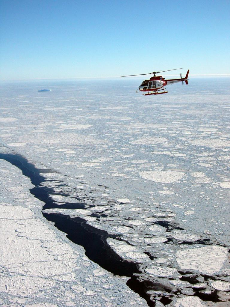 "An aerial view of the helicopter taking data of the sea ice below. Photo Credit: NSIDC Courtesy Alice O'Connor (<a href=""/cryosphere/gallery/photo/33291"">View photo detail.</a>) <br>"