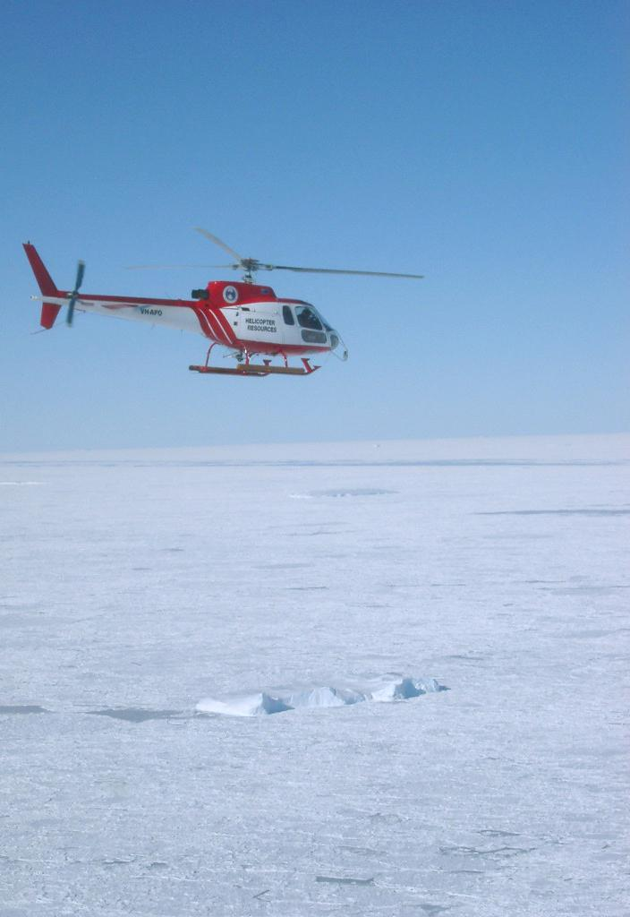 "The AS350 Squirrel (VH-AFO) airborne for floe-hopping. Photo Credit: NSIDC Courtesy Tony Worby (<a href=""/cryosphere/gallery/photo/33299"">View photo detail.</a>) <br>"