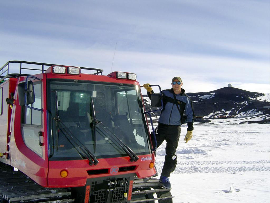 "Rob Bauer standing atop the tred of a PistenBully. Image Credit:  Courtesy Ted Scambos and Rob Bauer, NSIDC  <a href=""http://nsidc.org/antarctica/megadunes/"">Megadunes Web site</a> (<a href=""/cryosphere/gallery/photo/33011"">View photo detail.</a>) <br>"