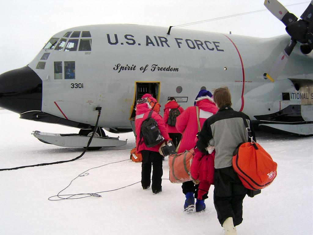 "The crew boarding the C-130 ""Spirit of Freedom"". Image Credit:  Courtesy Ted Scambos and Rob Bauer, NSIDC  <a href=""http://nsidc.org/antarctica/megadunes/"">Megadunes Web site</a> (<a href=""/cryosphere/gallery/photo/33063"">View photo detail.</a>) <br>"