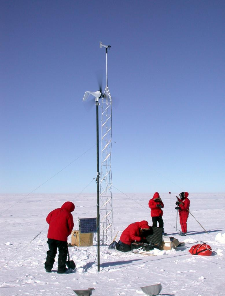 "The crew setting up an Automated Weather Station (AWS). Image Credit:  Courtesy Ted Scambos and Rob Bauer, NSIDC  <a href=""http://nsidc.org/antarctica/megadunes/"">Megadunes Web site</a> (<a href=""/cryosphere/gallery/photo/33071"">View photo detail.</a>) <br>"