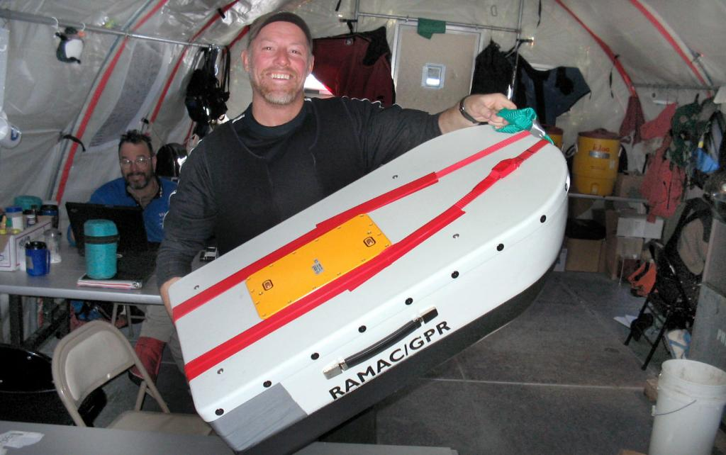 "Rob Bauer happily displaying the freshly duct-taped GPR system. Image Credit:  NSIDC courtesy Ted Scambos and Rob Bauer. (<a href=""/cryosphere/gallery/photo/33072"">View photo detail.</a>) <br>"