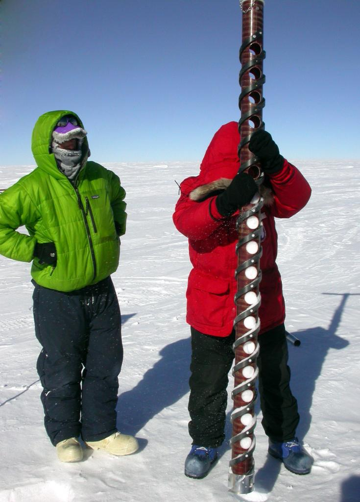 "Mac Cathles (left) and Makoto Suwa (right) removing the ice core sample from the dune. Image Credit:  NSIDC courtesy Ted Scambos and Rob Bauer. (<a href=""/cryosphere/gallery/photo/33074"">View photo detail.</a>) <br>"