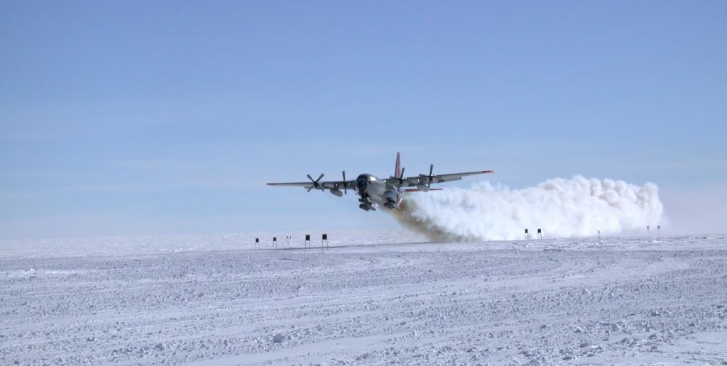 "The C-130 aircraft taking off with jet assistance. Image Credit:  NSIDC courtesy Ted Scambos and Rob Bauer. (<a href=""/cryosphere/gallery/photo/33076"">View photo detail.</a>) <br>"