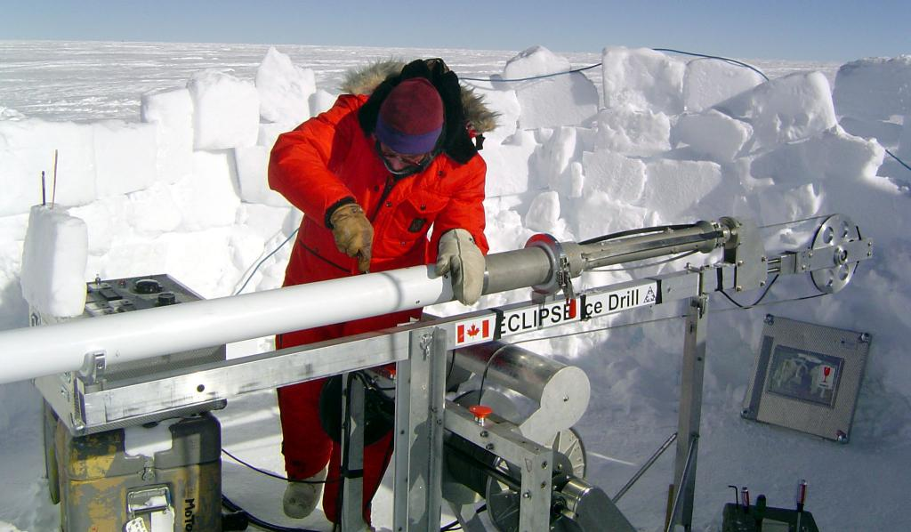 "Lou Albershardt carefully working with the ice core drill. Image Credit:  NSIDC courtesy Ted Scambos and Rob Bauer. (<a href=""/cryosphere/gallery/photo/33078"">View photo detail.</a>) <br>"