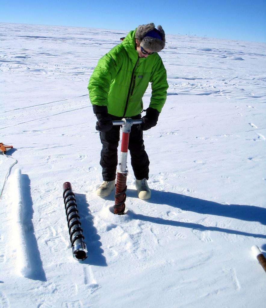 "Mac Cathles drilling an ice core sample. Image Credit:  NSIDC courtesy Ted Scambos and Rob Bauer. (<a href=""/cryosphere/gallery/photo/33077"">View photo detail.</a>) <br>"