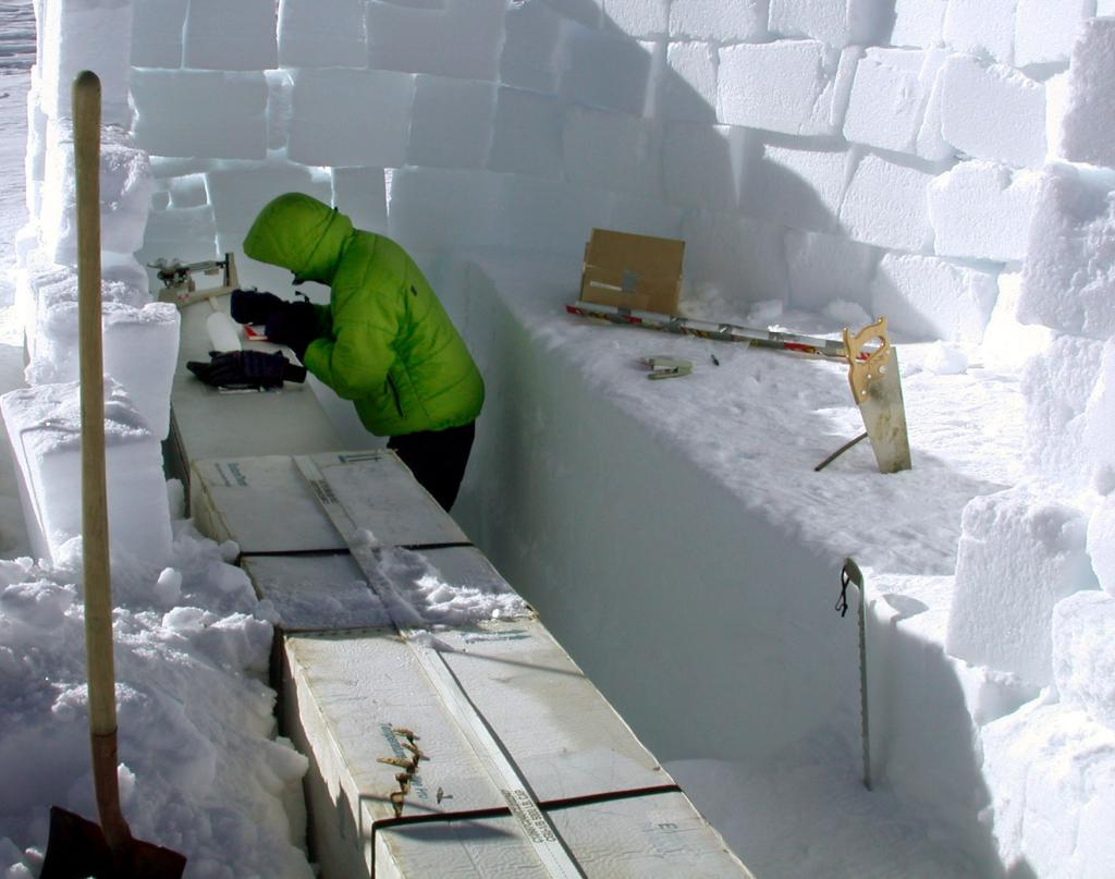 "Mac Cathles measuring the ice core sample in the snow pit. Image Credit:  NSIDC courtesy Ted Scambos and Rob Bauer. (<a href=""/cryosphere/gallery/photo/33080"">View photo detail.</a>) <br>"