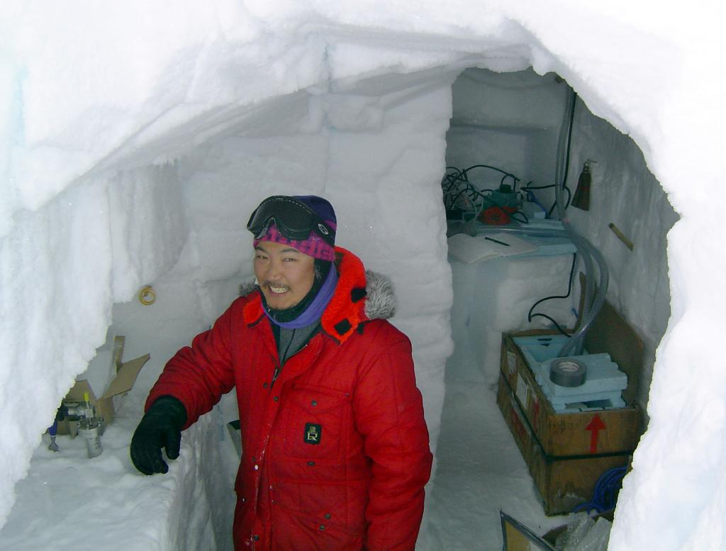 "Makoto Suwa in his science pit. Image Credit:  NSIDC courtesy Ted Scambos and Rob Bauer. (<a href=""/cryosphere/gallery/photo/33083"">View photo detail.</a>) <br>"