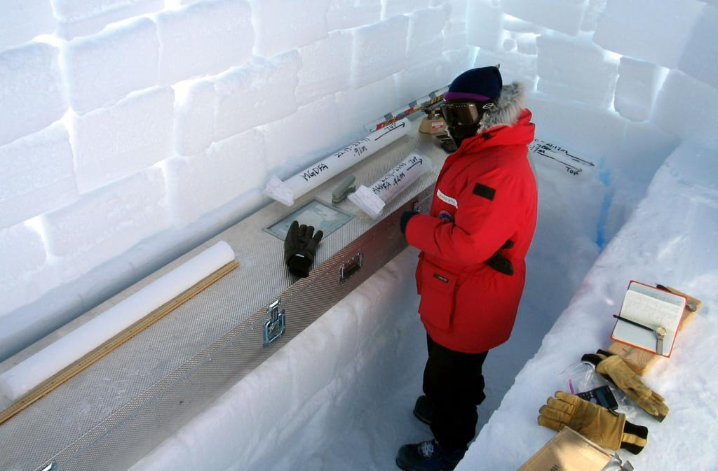 "Makoto Suwa weighing and taking measurements of the ice core samples. Image Credit:  NSIDC courtesy Ted Scambos and Rob Bauer. (<a href=""/cryosphere/gallery/photo/33079"">View photo detail.</a>) <br>"