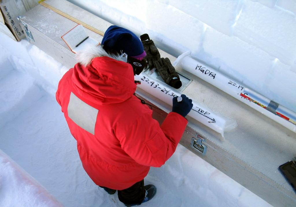 "Makoto Suwa weighing and taking measurements of the ice core samples. Image Credit:  NSIDC courtesy Ted Scambos and Rob Bauer. (<a href=""/cryosphere/gallery/photo/33081"">View photo detail.</a>) <br>"