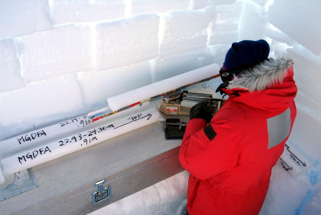 "Makoto Suwa weighing and taking measurements of the ice core samples. Image Credit:  NSIDC courtesy Ted Scambos and Rob Bauer. (<a href=""/cryosphere/gallery/photo/33082"">View photo detail.</a>) <br>"