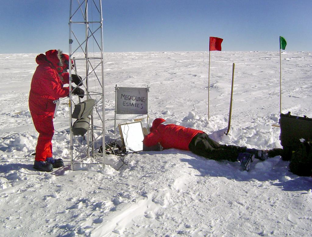 "Rob Bauer (left) and Terry Haran (right) working on the setup for the Automated Weather Station (AWS). Image Credit:  NSIDC courtesy Ted Scambos and Rob Bauer. (<a href=""/cryosphere/gallery/photo/33085"">View photo detail.</a>) <br>"
