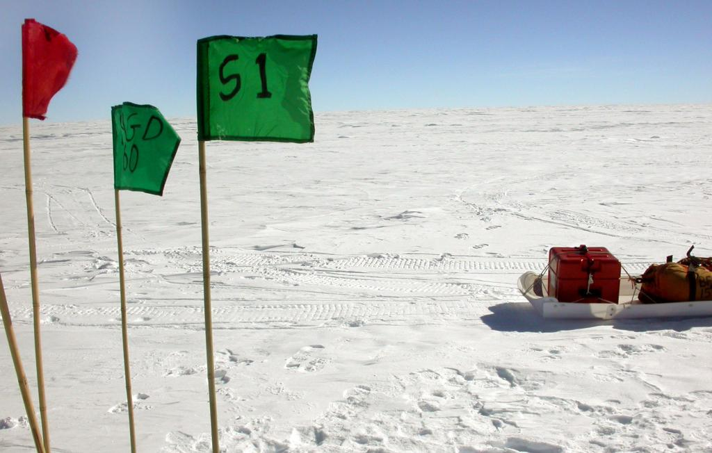 "The flags at the S1 dune. Image Credit:  NSIDC courtesy Ted Scambos and Rob Bauer. (<a href=""/cryosphere/gallery/photo/33093"">View photo detail.</a>) <br>"