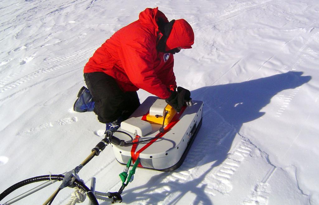 "Ted Scambos adjusting the GPR/GPS system. Image Credit:  NSIDC courtesy Ted Scambos and Rob Bauer. (<a href=""/cryosphere/gallery/photo/33106"">View photo detail.</a>) <br>"