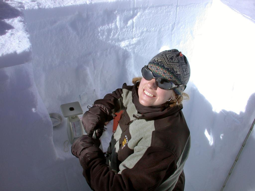 "Zoe Courville carefully weighing and measuring smaller samples. Image Credit:  NSIDC courtesy Ted Scambos and Rob Bauer. (<a href=""/cryosphere/gallery/photo/33107"">View photo detail.</a>) <br>"