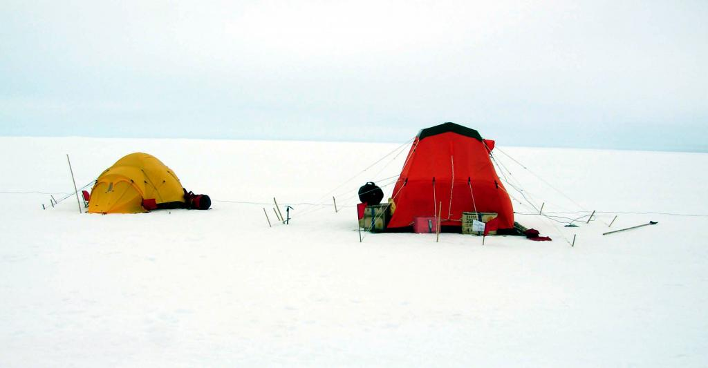 "The IceTrek team camped out in these tents on Iceberg A22a. PhotoCredit: Courtesy Ted Scambos and Rob Bauer, NSIDC  <a href=""http://nsidc.org/icetrek"">IceTrek Web site</a> (<a href=""/cryosphere/gallery/photo/32868"">View photo detail.</a>) <br>"