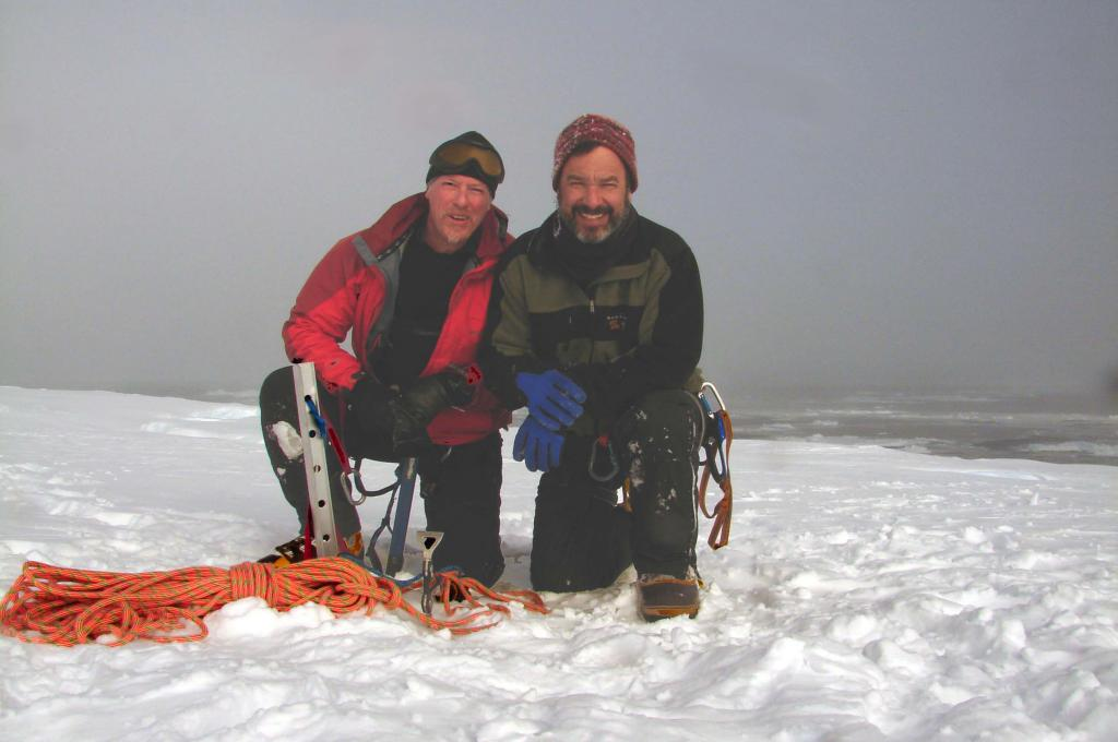 "Rob Bauer (left) & Ted Scambos (right) take a knee to remember their hike to the edge of AMIGOSberg. Photo Credit: Courtesy Ted Scambos and Rob Bauer, NSIDC <a href=""http://nsidc.org/icetrek"">IceTrek Web site</a> (<a href=""/cryosphere/gallery/photo/33318"">View photo detail.</a>) <br>"