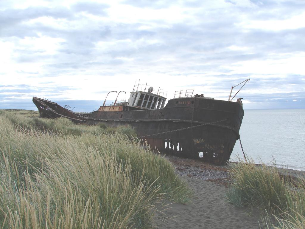 "An abandoned boat sits on the shore along the waterside of Chile. Photo Credit: Courtesy Ted Scambos and Rob Bauer, NSIDC  <a href=""http://nsidc.org/icetrek"">IceTrek Web site</a> (<a href=""/cryosphere/gallery/photo/33315"">View photo detail.</a>) <br>"