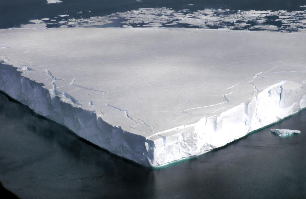 "This in-flight view shows Chip, the test iceberg used to try out equipment during IceTrek. Photo Credit: Courtesy Ted Scambos and Rob Bauer, NSIDC  <a href=""http://nsidc.org/icetrek"">IceTrek Web site</a> (<a href=""/cryosphere/gallery/photo/32898"">View photo detail.</a>) <br>"