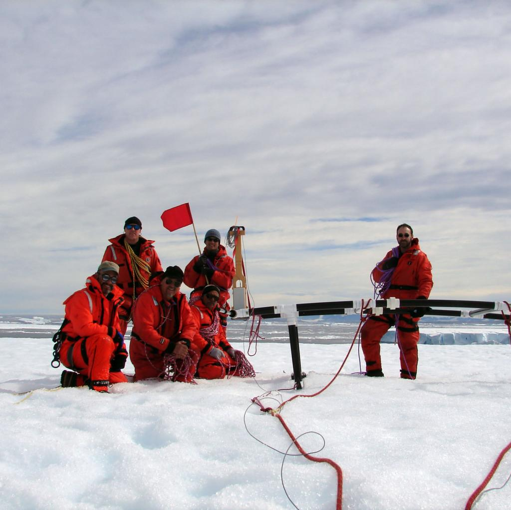"The IceTrek crew gathers for a photo on Chip, the test iceberg. Photo Credit: Courtesy Ted Scambos and Rob Bauer, NSIDC  <a href=""http://nsidc.org/icetrek"">IceTrek Web site</a> (<a href=""/cryosphere/gallery/photo/32894"">View photo detail.</a>) <br>"