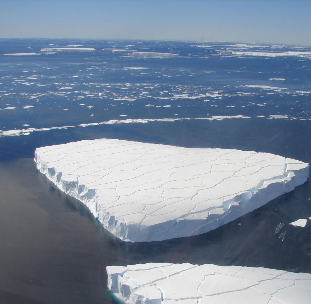 "An iceberg near Chip, the test berg, was fractured with cracks. Photo Credit: Courtesy Ted Scambos and Rob Bauer, NSIDC  <a href=""http://nsidc.org/icetrek"">IceTrek Web site</a> (<a href=""/cryosphere/gallery/photo/32901"">View photo detail.</a>) <br>"