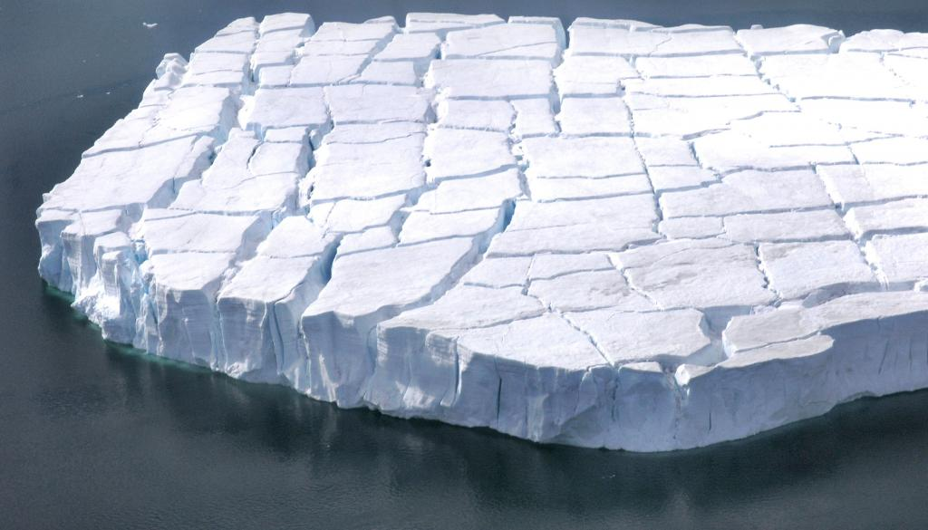 "An iceberg near Chip, the test berg, was fractured with cracks. Photo Credit: Courtesy Ted Scambos and Rob Bauer, NSIDC  <a href=""http://nsidc.org/icetrek"">IceTrek Web site</a> (<a href=""/cryosphere/gallery/photo/32905"">View photo detail.</a>) <br>"