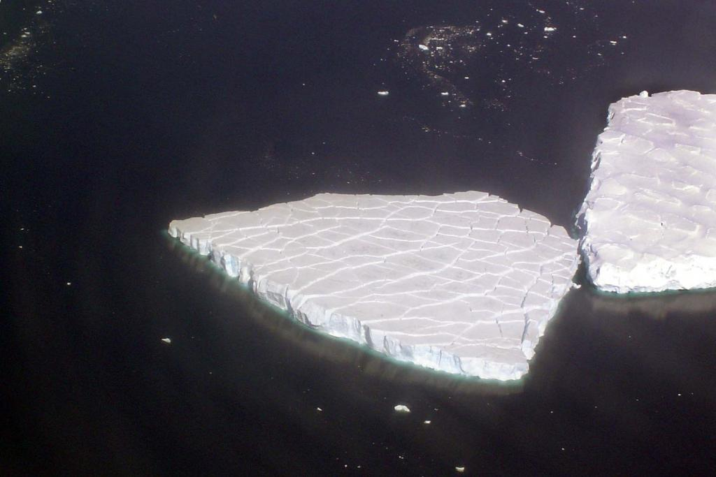 "This iceberg is shown for its fracturing surface features. Photo Credit: Courtesy Ted Scambos and Rob Bauer, NSIDC  <a href=""http://nsidc.org/icetrek"">IceTrek Web site</a> (<a href=""/cryosphere/gallery/photo/32902"">View photo detail.</a>) <br>"